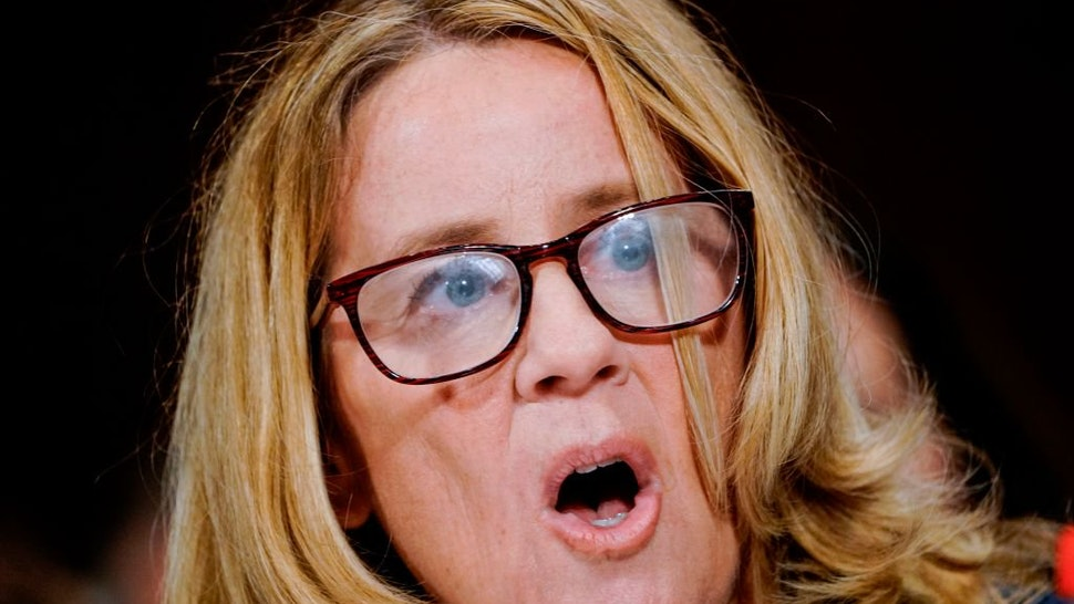 "Christine Blasey Ford testifies before the US Senate Judiciary Committee on Capitol Hill in Washington, DC, on September 27, 2018. - Blasey Ford told senators Thursday that she remains ""100 percent"" certain that Brett Kavanaugh, President Donald Trump's n"