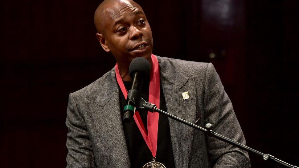 Dave Chappelle on stage at the W.E.B. Du Bois Medal Award Ceremony at Harvard University on October 11, 2018 in Cambridge, Massachusetts.