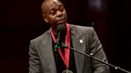 Dave Chappelle on stage at the W.E.B. Du Bois Medal Award Ceremony at Harvard University on October 11, 2018 in Cambridge, Massachusetts.