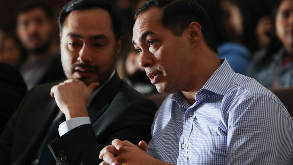 BELL GARDENS, CALIFORNIA - MARCH 04: Democratic presidential candidate Julian Castro (R) and his twin brother U.S. Rep. Joaquin Castro (D-TX) sit at a campaign appearance at Bell Gardens High School, in Los Angeles county, on March 4, 2019 in Bell Gardens, California. Castro, who served as Secretary of Housing and Urban Development (HUD) under President Barack Obama, is aiming to become the country's first Latino president. (