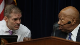 U.S. Rep. Jim Jordan (R-OH) (L) talks with House Oversight and Reform Committee Chairman Elijah Cummings (D-MD) during a hearing on March 14, 2019 in Washington, DC.
