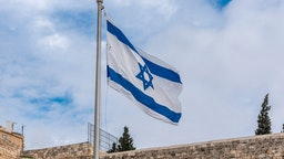Israel, Jerusalem - 31 December 2018: Israeli flag at the Western wall