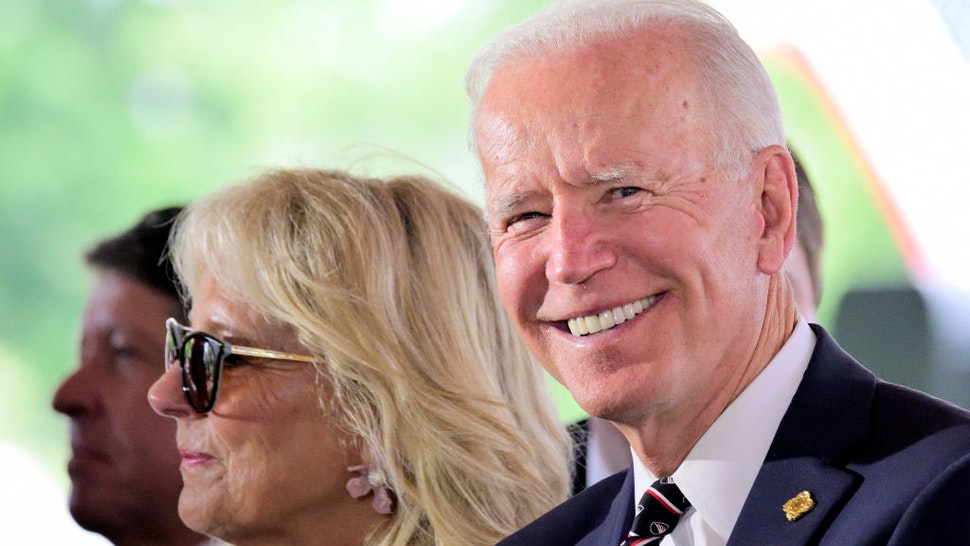 Presidential hopeful Former Vice President Joe Biden, joined by Dr. Jill Biden and granddaughter Natalie Biden on his side, attend the Delaware Memorial Day Ceremony, in New Castle, DE on May 30, 2019.