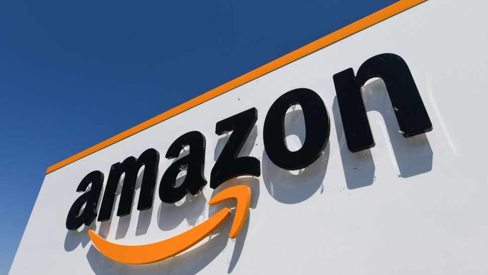 A picture shows the Amazon logo at the entrance of the Amazon logistics centre in Amiens, northern France, on July 23, 2019.