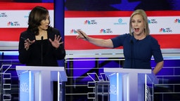 MIAMI, FLORIDA - JUNE 27: Democratic presidential candidate Sen. Kamala Harris (L) (D-CA) and Sen. Kirsten Gillibrand (D-NY) speak during the second night of the first Democratic presidential debate on June 27, 2019 in Miami, Florida. A field of 20 Democratic presidential candidates was split into two groups of 10 for the first debate of the 2020 election, taking place over two nights at Knight Concert Hall of the Adrienne Arsht Center for the Performing Arts of Miami-Dade County, hosted by NBC News, MSNBC, and Telemundo.