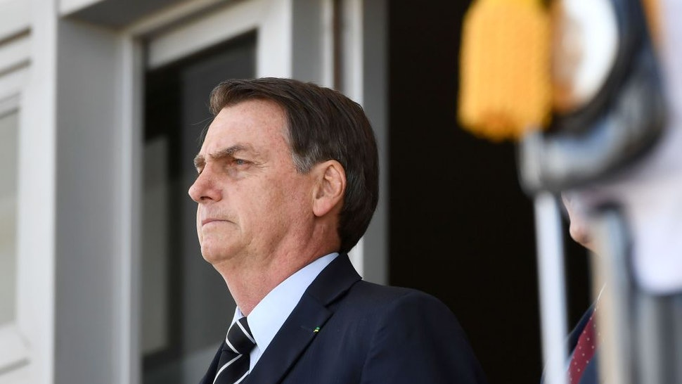 Brazilian President Jair Bolsonaro attends the changing of the guard ceremony at Planalto Palace in Brasilia, on July 31, 2019. - Bolsonaro met with US Secretary of Commerce Wilbur Ross Wednesday in Brasilia.