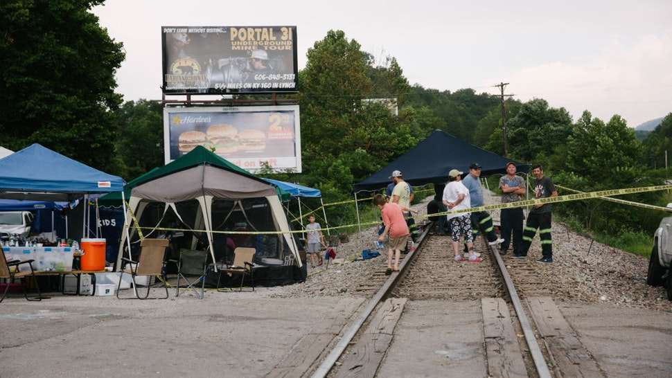 Supporters of miners stand on train tracks in Cumberland, Kentucky, U.S., on Friday, Aug. 2, 2019. The miners have been working in shifts to block railroad tracks leading to a Blackjewel mine outside since Monday afternoon, Harlan County Judge-Executive Dan Mosley said in an interview. They're demanding back pay for work done in weeks leading up to the bankruptcy, after checks issued by Blackjewel bounced or never arrived. Photographer: Meg Roussos/Bloomberg via Getty Images