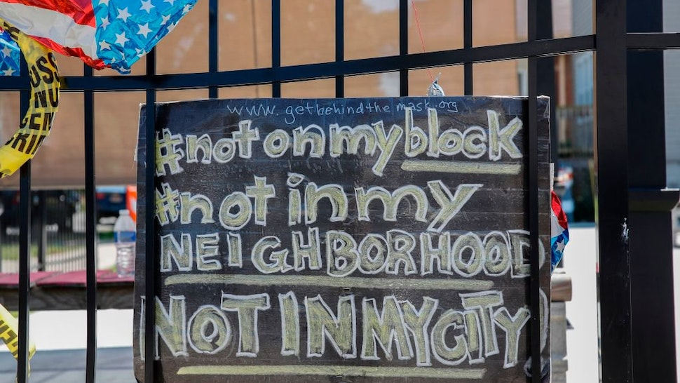 Protest Sign On Fence