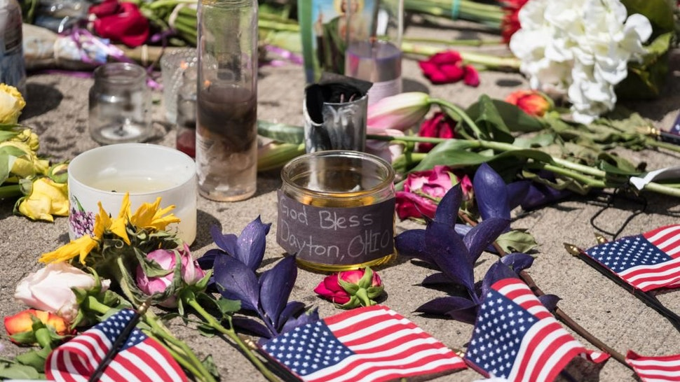 Candles and flowers a placed in front of Ned Peppers bar after the mass shooting over the weekend in Dayton, Ohio on August 5, 2019. - US President Donald Trump urged Republicans and Democrats to agree on tighter gun control and suggested legislation coul