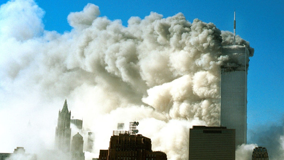 Smoke pours out of the World Trade Center after the twin towers were struck by two planes during a suspected terrorist attack September 11, 2001 in New York City.