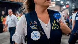 A Walmart employee attends a community memorial service for the 22 victims of the mass shooting at Southwest University Park in El Paso, Texas on August 14, 2019.