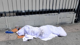 Homeless person sleeping in the street