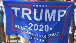 President Trump and USA supporter holds 'Trump 2020 - Keep America Great' banner, ahead of the ceremony commemorating the 80th anniversary of the outbreak of World War II. On Sunday, September 1, 2019, in Warsaw, Poland.