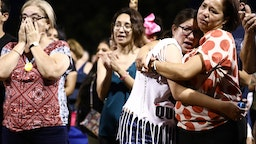 EL PASO, TEXAS - AUGUST 04: People react and embrace each other during an interfaith vigil for victims of a mass shooting which left at least 20 people dead, on August 4, 2019 in El Paso, Texas. A 21-year-old male suspect was taken into custody in the city which sits along the U.S.-Mexico border. At least 26 people were wounded.