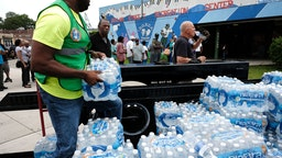 A pallet of bottled water is delivered to a recreation center on August 13, 2019 in Newark, New Jersey. Residents of Newark, the largest city in New Jersey, are to receive free water after lead was found in the tap water.