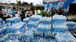 NEWARK, NEW JERSEY - AUGUST 13: A pallet of bottled water is delivered to a recreation center on August 13, 2019 in Newark, New Jersey. Residents of Newark, the largest city in New Jersey, are to receive free water after lead was found in the tap water. It was reported over the weekend that lead levels in some areas of the city were still not safe and the city has begun distributing bottled water for cooking and drinking.