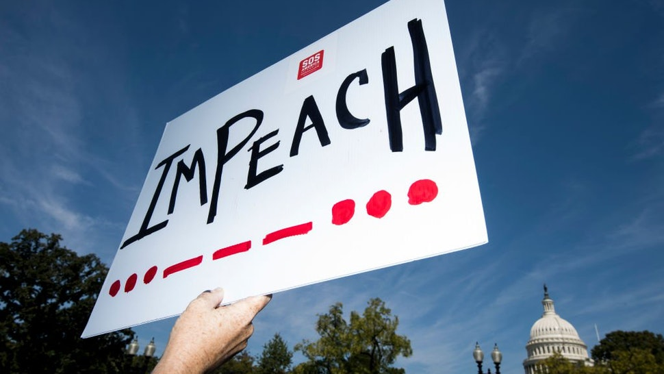 "An ""Impeach"" protest sign"