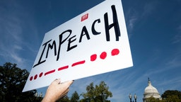 "An ""Impeach"" protest sign"