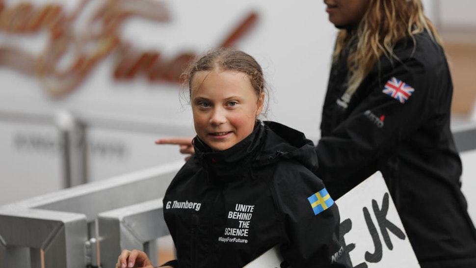 """Teenage climate activist Greta Thunberg holding a sign that says """"school Strike for Climate"""" in swedish arrives into New York City after crossing the Atlantic in a sailboat on on August 28, 2019 in New York City."""