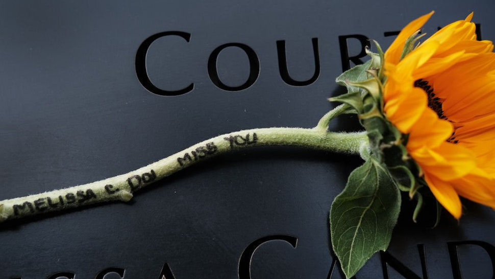 NEW YORK, NEW YORK - SEPTEMBER 10: A message is written to a loved one on the stem of a flower that is placed over a name at the World Trade Center Memorial in lower Manhattan on September 10, 2019 in New York City. New York City is preparing to commemora
