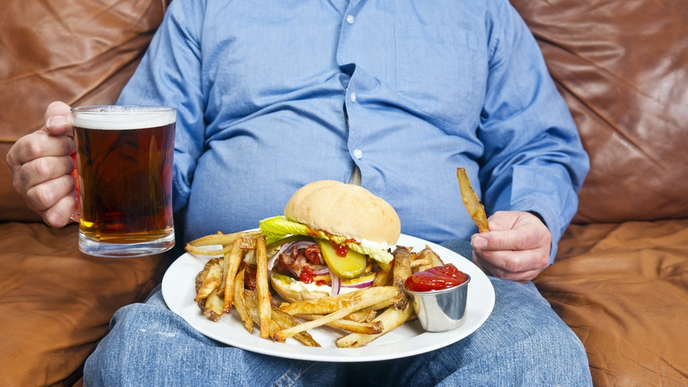 Fat guy with a burger.