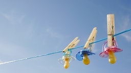 Pacifiers in clothes line