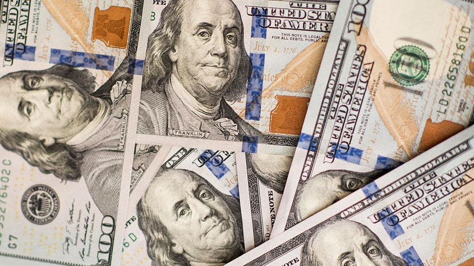 U.S. one-hundred dollar bills are arranged for a photograph in Hong Kong, China, on Monday, July 20, 2015. The yuan has proven to be among the more resilient emerging-market currencies this year, having fallen less than 0.1 percent versus the dollar as China cut interest rates and the U.S. prepared to raise. Photographer: Xaume Olleros/Bloomberg via Getty Images