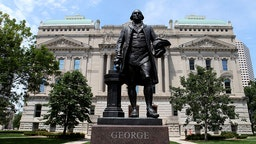 INDIANAPOLIS - JULY 16: George Washington statue stands outside the Indiana State Capitol Building on July 16, 2015 in Indianapolis, Indiana.