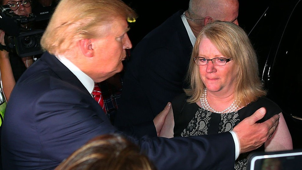 NORWOOD, MA - AUGUST 28: A fundraiser was held at the mansion of car dealer Ernie Boch Jr. for Republican presidential hopeful Donald Trump. As he leaves, Trump hugs a crying Maureen Maloney who's son, Matthew Denice from Milford was killed in 2011 in a m