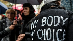 "WARSAW, POLAND - OCTOBER 03: (SOUTH AFRICA AND POLAND OUT) Wwoman with an inscription on her jacket ""My body, my choice"" participates in the Black Monday, a nationwide women's pro-abortion protest on October 03, 2016 at Swietokrzyska Street in Warsaw, Pol"