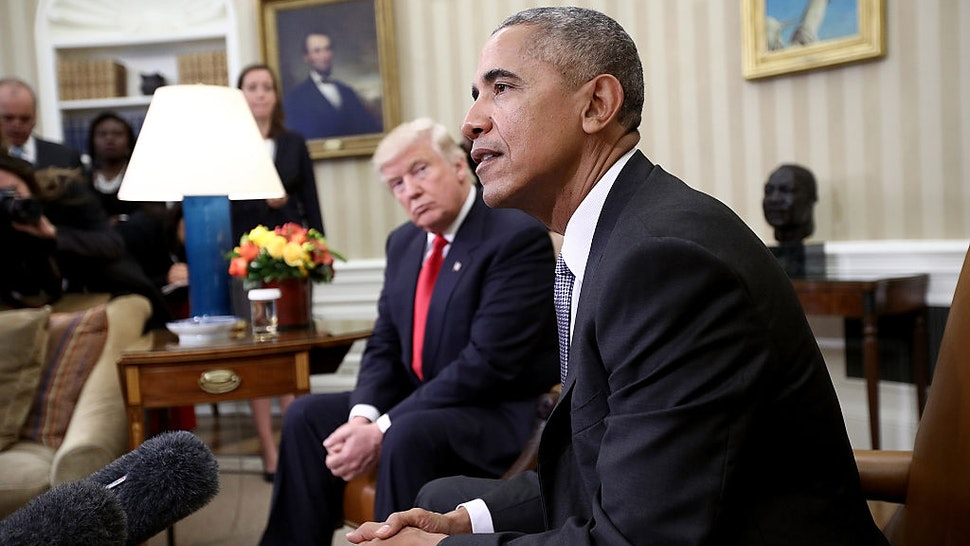 President-elect Donald Trump (L) listens as U.S. President Barack Obama speaks during a meeting in the Oval Office November 10, 2016 in Washington, DC. Trump is scheduled to meet with members of the Republican leadership in Congress later today on Capitol Hill. (Photo by Win McNamee/Getty Images)