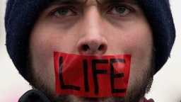 A man wears tape over his mouth during protests at the 44th annual March for Life on January 27, 2017 in Washington, DC. Anti-abortion activists are gathering for the 44th annual March for Life in Washington, protesting the 1973 Supreme Court decision leg
