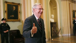 WASHINGTON, DC - FEBRUARY 07: Senate Majority Leader Mitch McConnell (R-KY) gives the thumbs-up to the media after the Senate voted to confirm Betsy DeVos as education secretary on Capitol Hill on February 7, 2017 in Washington, D.C. The historic 51-50 vote was decided by a tie-breaking vote from Vice President Mike Pence.