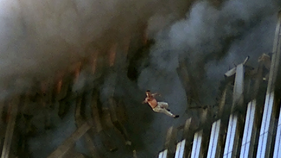 A man leaps to his death from a fire and smoke filled Tower One of the World Trade Center September 11, 2001 in New York City after terrorists crashed two hijacked passenger planes into the twin towers.