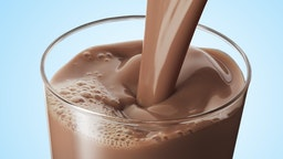Chocolate milk pouring into a glass.
