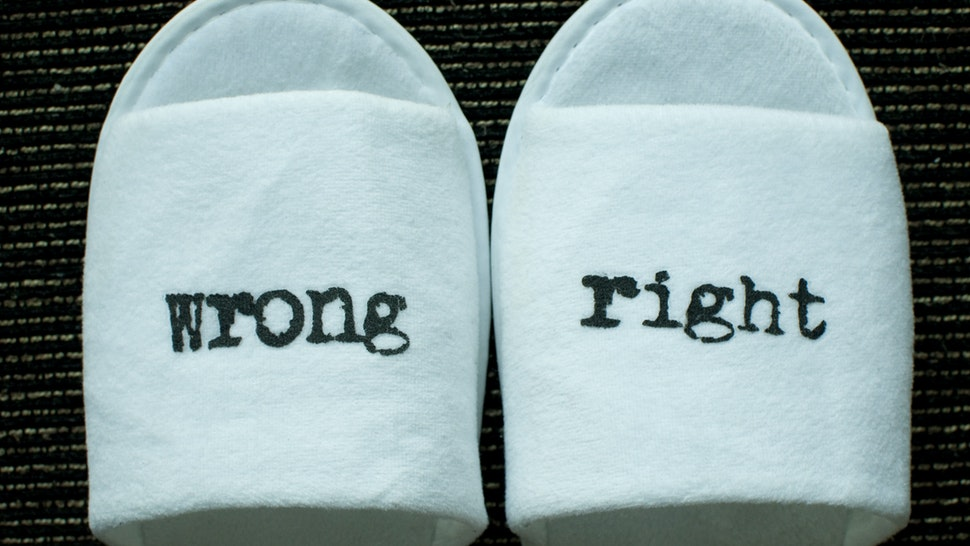 Right and wrong signs on a pair of slippers