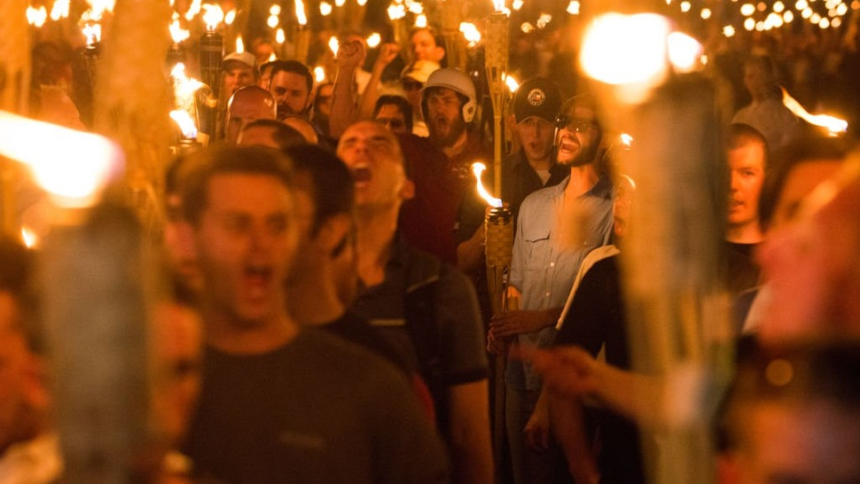 Neo Nazis, Alt-Right, and White Supremacists take part a the night before the 'Unite the Right' rally in Charlottesville, VA, white supremacists march with tiki torchs through the University of Virginia campus.
