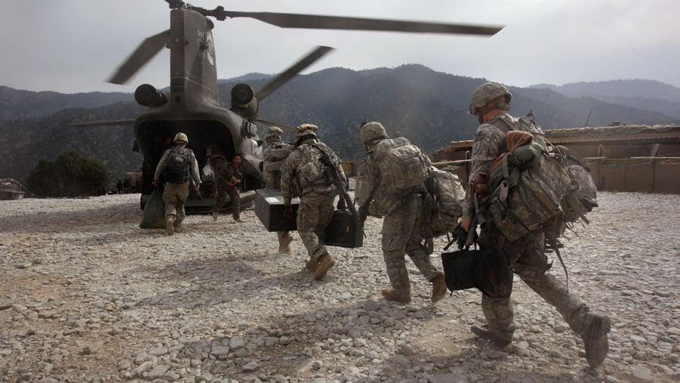 KORENGAL VALLEY, AFGHANISTAN - OCTOBER 27: U.S. soldiers board an Army Chinook transport helicopter after it brought fresh soldiers and supplies to the Korengal Outpost on October 27, 2008 in the Korengal Valley, Afghanistan. The military spends huge effort and money to fly in supplies to soldiers of the 1-26 Infantry based in the Korengal Valley, site of some of the fiercest fighting of the Afghan war. The unpaved road into the remote area is bad and will become more treacherous with the onset of winter.