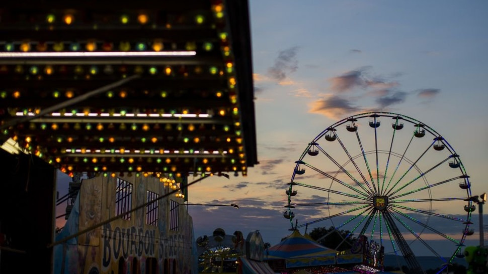 WASHINGTON, USA - SEPTEMBER 15: The sun sets over the amusement rides at The Great Frederick Fair in Frederick, Md., United States on September 15, 2017.