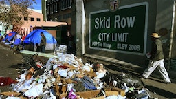 Trash lies beside the Skid Row City Limit mural as the city begins its annual homeless count in Los Angeles, California on January 26, 2018. Thousnads of volunteers will fan out across Los Angeles County during the three-night count of homeless people whose population is estimated to be nearly 60,000 strong.