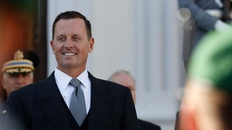 Newly accredited US Ambassador Richard Allen Grenell stands in front of a military honor guard during an accreditation ceremony for new Ambassadors in Berlin, Germany, on May 08, 2018.