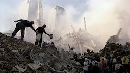 UNITED STATES - SEPTEMBER 13: Rescuers work to free a victim from under the rubble at the site of the World Trade Center, demolished in a terrorist attack.