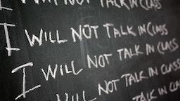 """Chalk board reading """"I will not talk in class"""""""