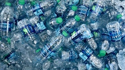 SANTA FE, NM - JULY 4, 2018: A tub filled with ice and plastic bottles of Dasani purified bottled water being given away at a Fourth of July holiday event in Santa Fe, New Mexico. Dasani is a brand of bottled water from the Coca-Cola company.