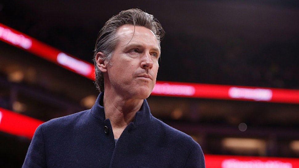 Governor of California Gavin Newsom looks on during the game between the Chicago Bulls and the Sacramento Kings at Golden 1 Center on March 17, 2019 in Sacramento, California.