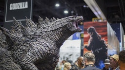 SAN DIEGO, CALIFORNIA - JULY 19: General view of the atmosphere at the Godzilla booth at 2019 Comic-Con International on July 19, 2019 in San Diego, California
