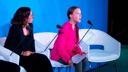 Youth Climate activist Greta Thunberg speaks next to Paloma Costa during the UN Climate Action Summit on September 23, 2019 at the United Nations Headquarters in New York City.