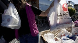 A Woman Buys Groceries In San Francisco In June 2007