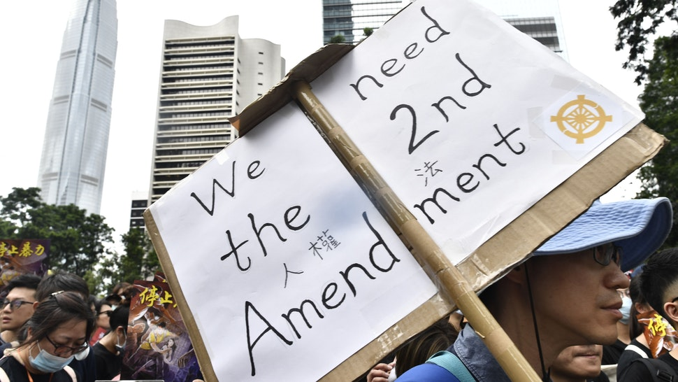 Protesters march during a demonstration in Hong Kong on July 28, 2019. - Defiant pro-democracy protesters in Hong Kong were readying for another big rally, a day after police fired rubber bullets and tear gas in the latest violent confrontation that has plunged the financial hub deeper into crisis.