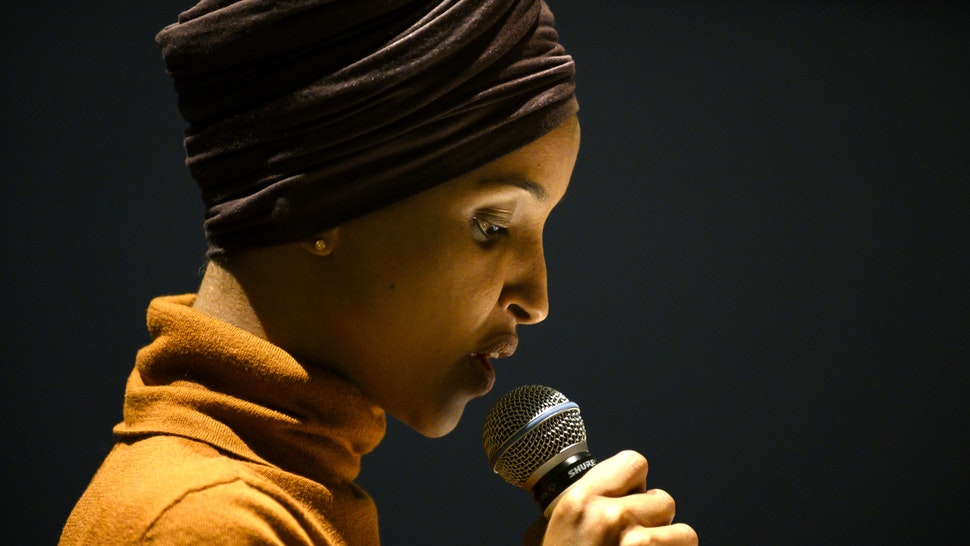 MINNEAPOLIS, MN - AUGUST 27: Rep. Ilhan Omar (D-MN) speaks at a community forum on immigration at the Colin Powell Center on August 27, 2019 in Minneapolis, Minnesota. Omar joined a panel to discuss immigration policy.